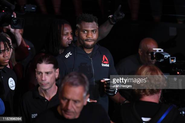 Francis Ngannou of Cameroon walks out towards the Octagon prior to facing Junior Dos Santos of Brazil in their heavyweight bout during the UFC Fight...