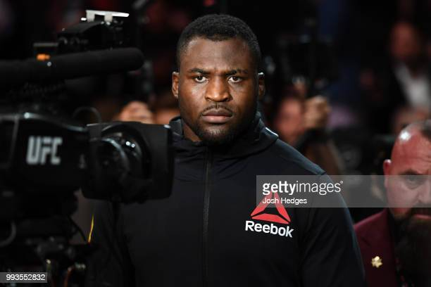 Francis Ngannou of Cameroon walks to the Octagon to face Derrick Lewis in their heavyweight fight during the UFC 226 event inside TMobile Arena on...