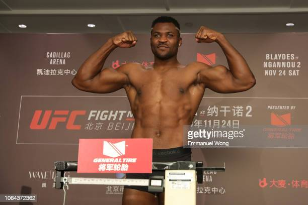 Francis Ngannou poses on the scale during the UFC Fight Night weighin at Wanda Realm Hotel on November 23 2018 in Beijing China