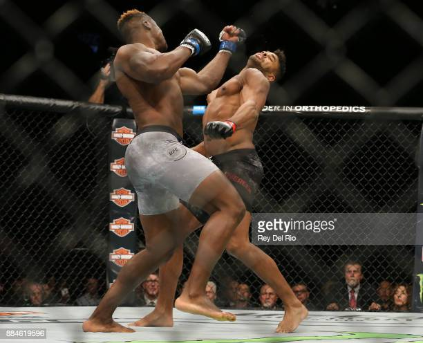 Francis Ngannou punches Alex Oliveira during the UFC 218 event at Little Caesars Arena on December 2 2017 in Detroit Michigan