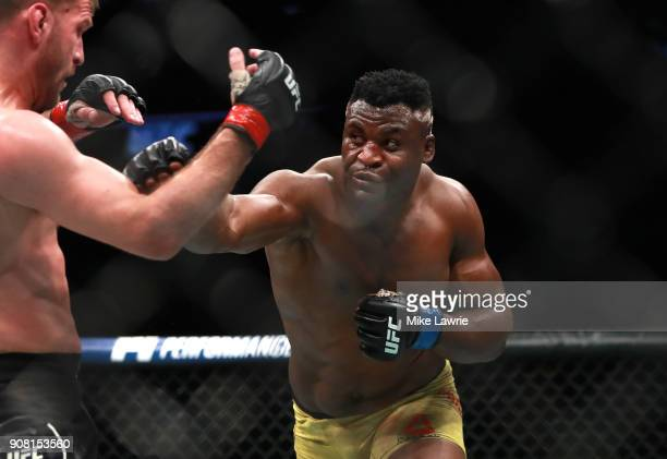 Francis Ngannou throws a punch against Stipe Miocic in their Heavyweight Championship fight during UFC 220 at TD Garden on January 20 2018 in Boston...