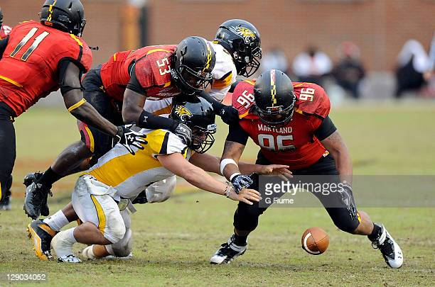 J Francis of the Maryland Terrapins recovers a fumble against the Towson Tigers at Byrd Stadium on October 1 2011 in College Park Maryland