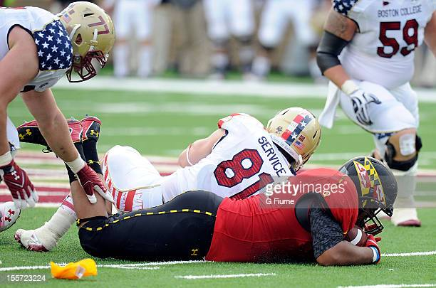 J Francis of the Maryland Terrapins recovers a fumble against the Boston College Eagles at Alumni Stadium on October 27 2012 in Chestnut Hill...