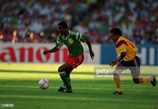Francis Oman Biyik of Cameroon takes the ball past Luis Herrera of Colombia during the FIFA World Cup Finals 1990 Second Round match between Cameroon...