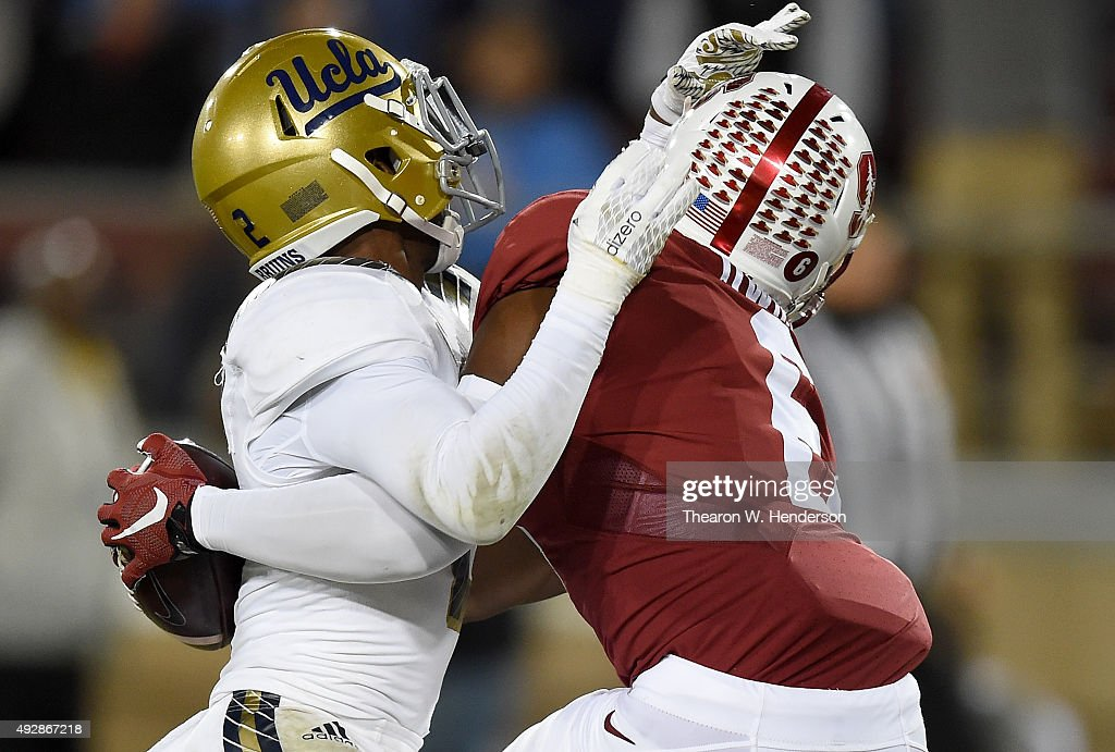 Francis Owusu #6 of the Stanford Cardinal's catches a touchdown pass up against the back of Jaleel Wadood #2 of the UCLA Bruins in the third quarter of an NCAA football game at Stanford Stadium on October 15, 2015 in Stanford, California.