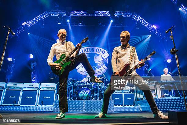 Francis Rossi and John Edwards of Status Quo perform on stage at The O2 Arena on December 13 2015 in London England