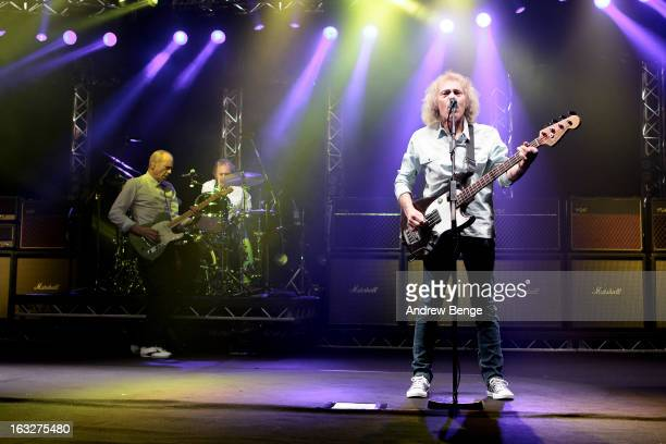 Francis Rossi Matt Letley and Alan Lancaster of Status Quo performs on stage in concert at Manchester Apollo on March 6 2013 in Manchester England