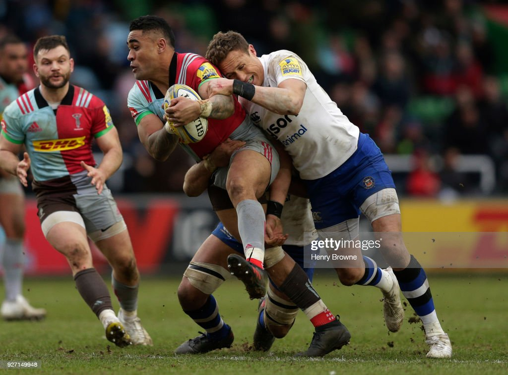 Francis Saili of Harlequins tackled by James Wilson (r) and Taulupe Faletau of Bath Rugby during the Aviva Premiership match between Harlequins and Bath Rugby at Twickenham Stoop on March 4, 2018 in London, England.
