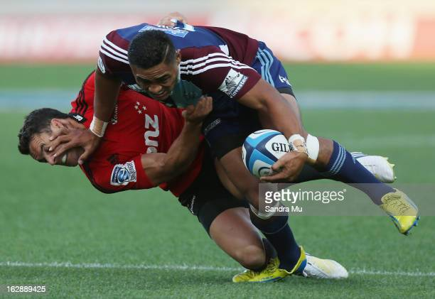 Francis Saili of the Blues fends off Daniel Carter of the Crusaders during the round 3 Super Rugby match between the Blues and the Crusaders at Eden...