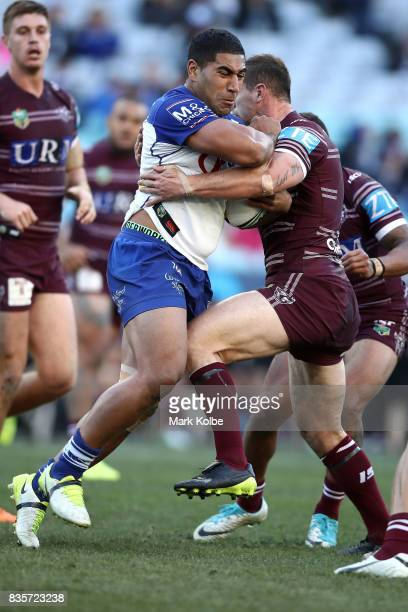 Francis Tualau of the Bulldogs is tackled during the round 24 NRL match between the Canterbury Bulldogs and the Manly Sea Eagles at ANZ Stadium on...