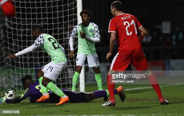 Francis Uzoho of Nigeria saves a shot from Aleksandar Mitrovic of Serbia during the International Friendly match between Nigeria and Serbia at The...