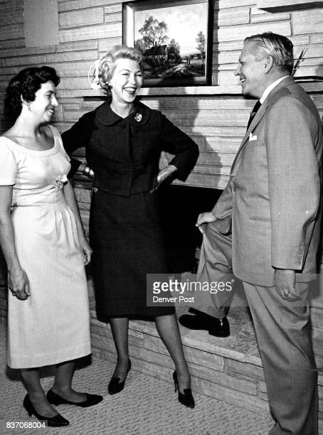 Francis Van Derbur chairman of the Civic Theatre membership committee chats with Mrs J E Manning and Mrs Robert Collett in whose home the third...