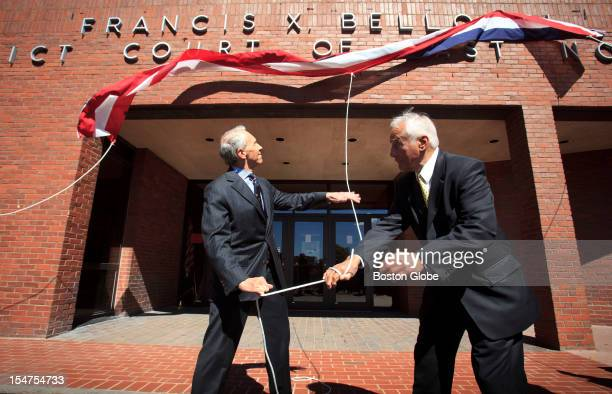 Francis X Bellotti right and David H Souter a former associate justice of the United States Supreme Court left unveiled the new name on the Old East...