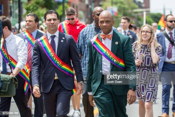 Francis X Suarez mayor of Miami left and Oliver G Gilbert III mayor of Miami Gardens march in the 2018 Boston Pride Parade on June 9 2018 in Boston...