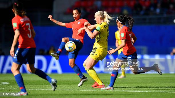 Francisca Lara of Chile is challenged by Caroline Seger of Sweden during the 2019 FIFA Women's World Cup France group F match between Chile and...