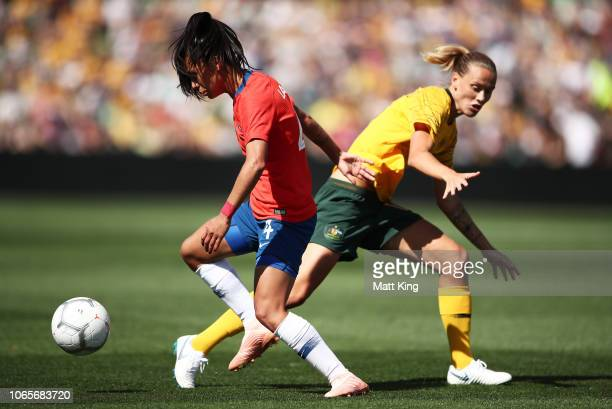 Francisca Lara of Chile is challenged by Emily van Egmond of Australia during the International Friendly match between the Australian Matildas and...