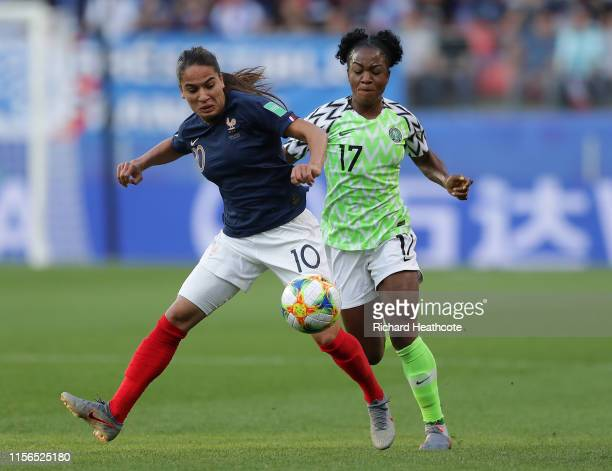 Francisca Ordega of Nigeria and Amel Majri of France battle for the ball during the 2019 FIFA Women's World Cup France group A match between Nigeria...