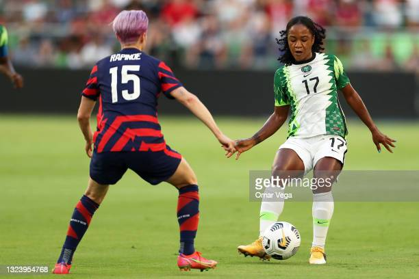 Francisca Ordega of Nigeria controls the ball against Megan Rapinoe of United States during the Summer Series game between United States and Nigeria...