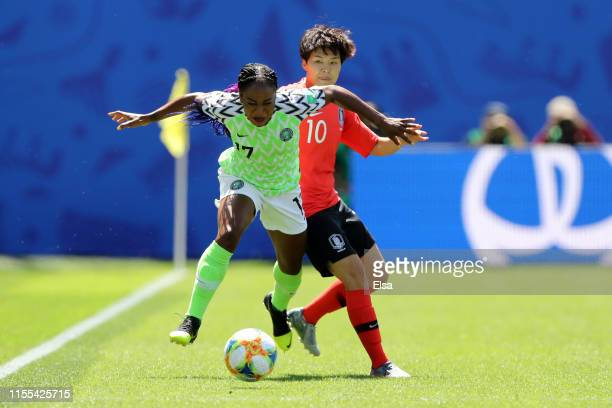 Francisca Ordega of Nigeria is challenged by Soyun Ji of Korea Republic during the 2019 FIFA Women's World Cup France group A match between Nigeria...