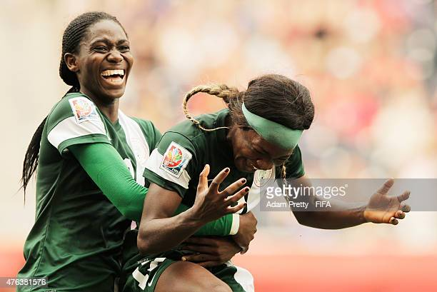 Francisca Ordega of Nigeria is congratulated by Asisat Oshoala of Nigeria after scoring the third goal during the FIFA Women's World Cup Canada 2015...