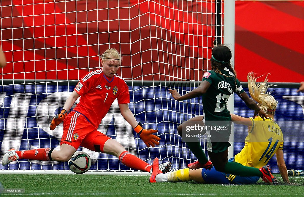 Francisca Ordega #17 of Nigeria scores the game-tying goal past Amanda Ilestedt #14 and goalkeeper Hedvig Lindahl #1 of Sweden during the FIFA Women's World Cup Canada 2015 Group D match between Sweden and Nigeria at Winnipeg Stadium on June 8, 2015 in Winnipeg, Canada.