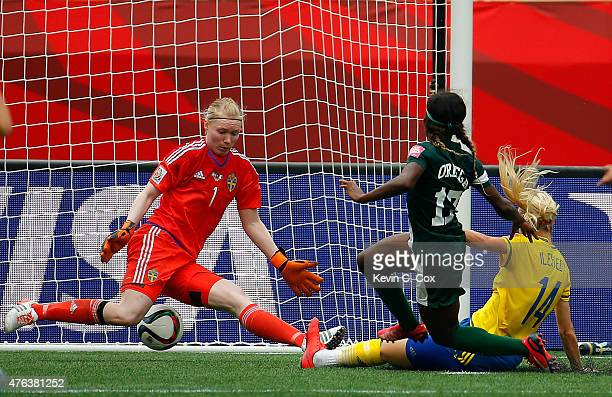 Francisca Ordega of Nigeria scores the game-tying goal past Amanda Ilestedt and goalkeeper Hedvig Lindahl of Sweden during the FIFA Women's World Cup...