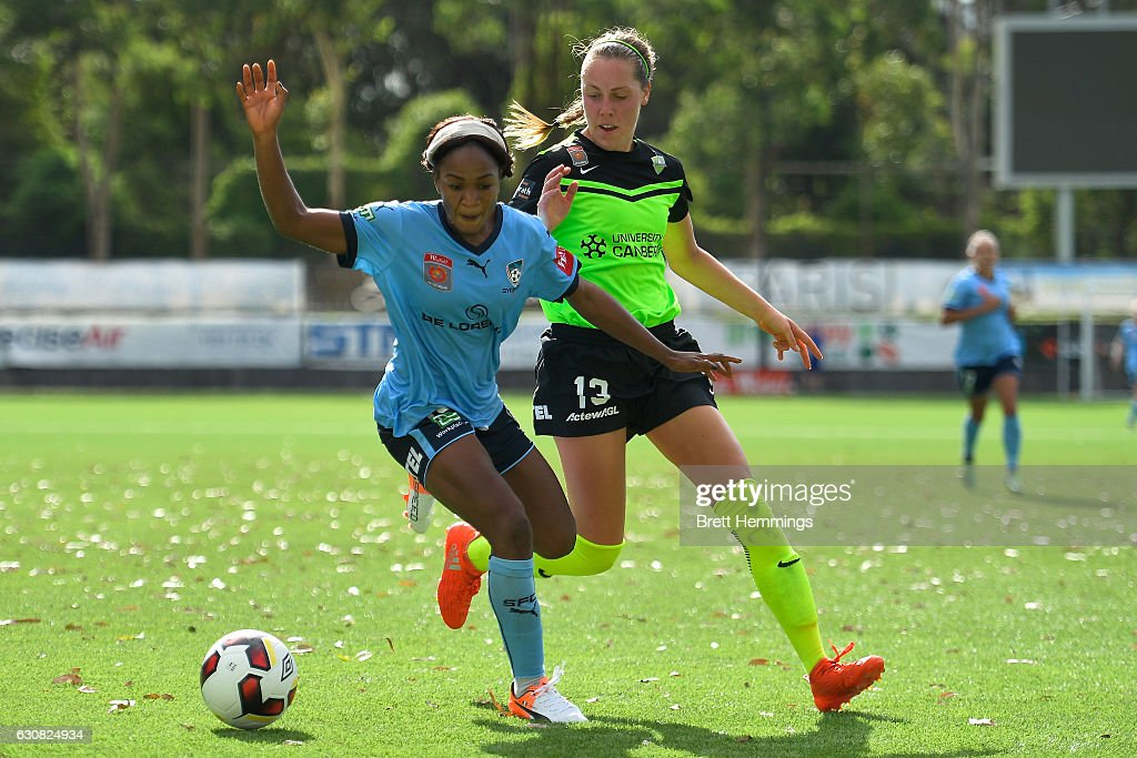 Francisca Ordega of Sydney is tackled by Celeste Boureille of Canberra during the round 10 W-League match between Sydney and Canberra at Lambert Park on January 3, 2017 in Sydney, Australia.