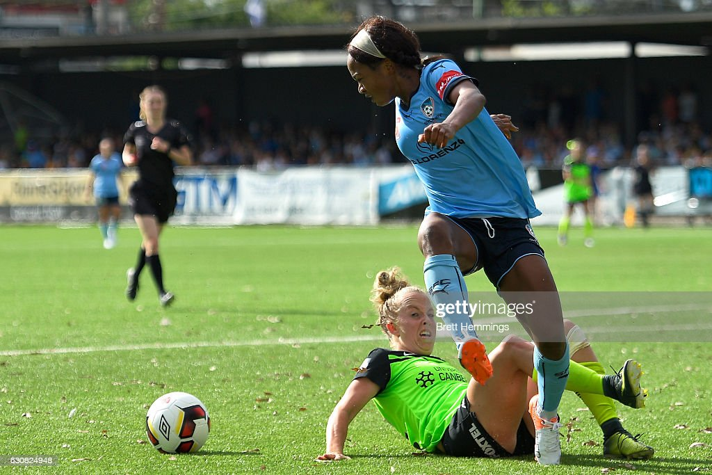 Francisca Ordega of Sydney is tackled by Hannah Brewer of Canberra during the round 10 W-League match between Sydney and Canberra at Lambert Park on January 3, 2017 in Sydney, Australia.