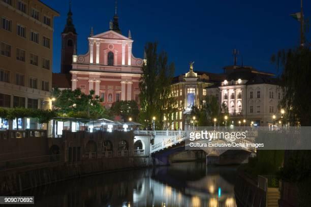 Franciscan Church of the Annunciation and Triple Bridge over the Ljubljanica River at night, Ljubljana, Brezovica Commune, Slovenia