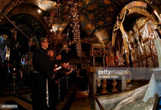 Franciscan Custos Father Francesco Patton and friars pray at the Golgotha at the Church of the Holy Sepulchre at the end of the weekly Via Dolorosa...
