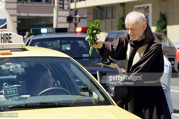 Franciscan friar Father Louis Vitale blesses a taxicab driver in front of St Boniface Catholic Church August 30 2005 in San Francisco California The...