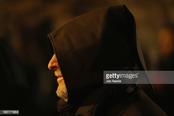 Franciscan friar walks in a religious procession through the streets of the hometown of Saint Francis of Assisi on March 15 2013 in Assisi Italy...