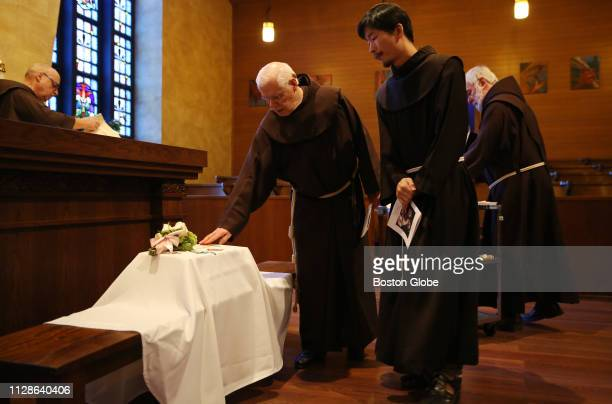 Franciscan Friars pause over Angela's casket after a funeral held at St Anthony Shrine by the Lazarus Ministry for the baby girl whose parents never...