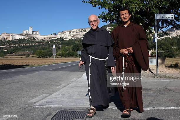 Franciscan friars walk along the road between the towns of Assisi and Santa Maria Degli Angeli prior to Pope Francis' visit on October 3 2013 in...