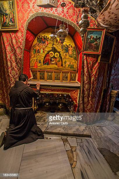 CONTENT] Franciscan monk in prayer at the altar in the Grotto of Church of the Nativity the spot believed to be the birth place of Jesus Christ...