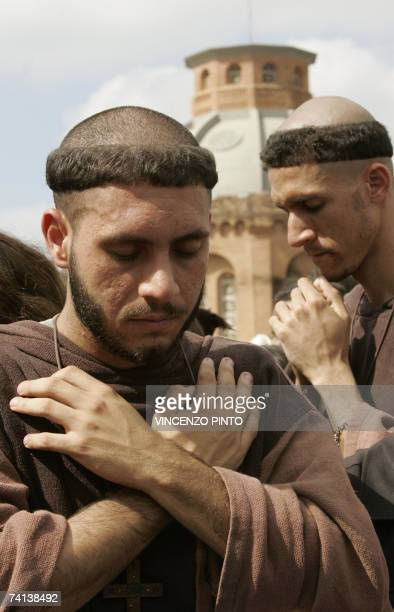 Franciscan monks pray during the open-air mass celebrated by Pope Benedict XVI in the vast explanade of the Aparecida basilica, in Aparecida, some...