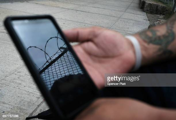 Francisco a patient at a Brooklyn methadone clinic for those addicted to heroin looks at the 12 steps program of Alcoholics Anonymous on his phone to...