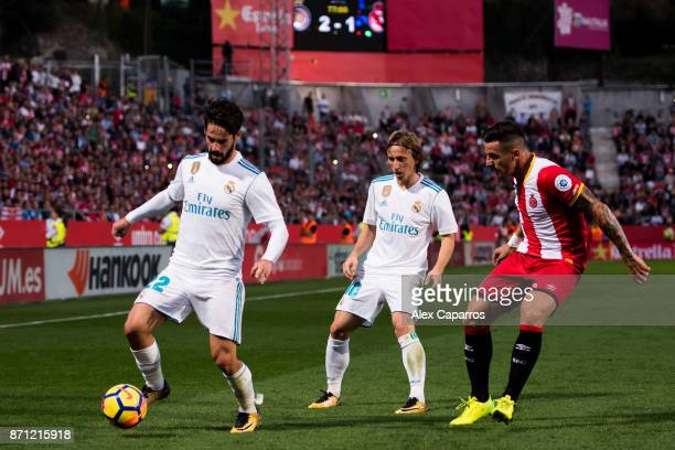 Francisco Alarcon 'Isco' of Real Madrid CF controls the ball next to his teammate Luka Modric and Francisco Aday of Girona FC during the La Liga...