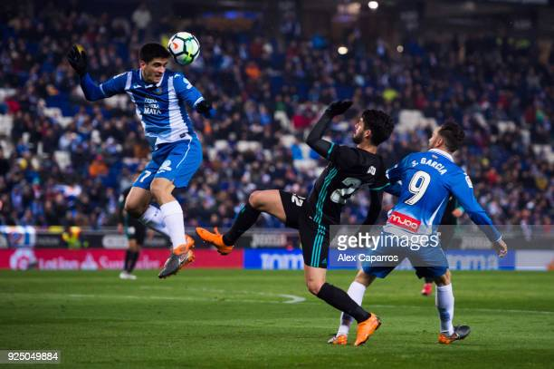 Francisco Alarcon 'Isco' of Real Madrid CF fights for the ball with Gerard Moreno and Sergio Garcia of RCD Espanyol during the La Liga match between...