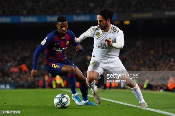 Francisco Alarcon 'Isco' of Real Madrid takes on Nelson Semedo of Barcelona during the Liga match between FC Barcelona and Real Madrid CF at Camp Nou...