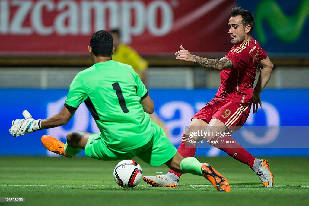 Francisco Alcacer (R) of Spain strikes the ball against goalkeeper Keylor Navas (L) of Costa Rica during the international friendly match between Spain and Costa Rica at Reino de Leon Stadium on June 11, 2015 in Leon, Spain.