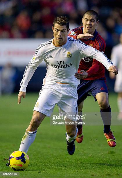 Francisco Andres Silva of CA Osasuna holds off Cristiano Ronaldo of Real Madrid CF before his sending off by referee Carlos Clos Gomez during the La...