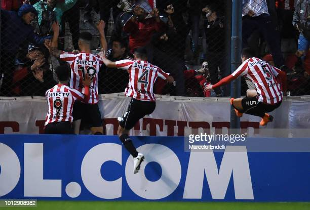 Francisco Apaolaza of Estudiantes celebrates with teammates after scoring the first goal of his team during a round of sixteen first leg match...
