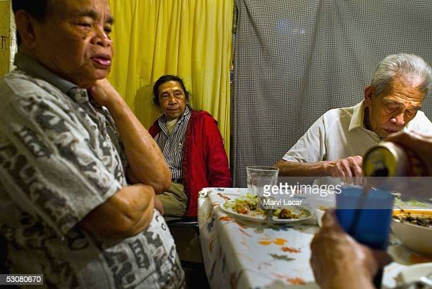 Francisco Boncato Sixto Gagni and Jose Mempin gather at the dinner table at their home May 4 2005 in San Francisco To save money on rent they share a...
