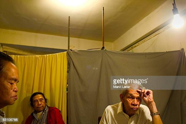 Francisco Boncato Sixto Gagni and Jose Mempin gather at the dinner table at their home May 4 2005 in San Francisco To save money on rent the they...