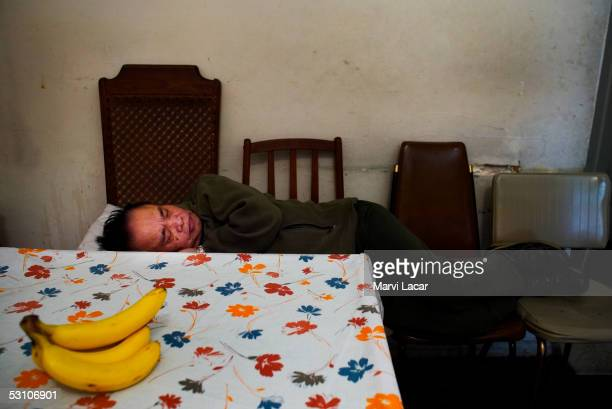 Francisco Boncato sleeps beside the dinner table at his home April 14 2005 in San Francisco He fought the Japanese during WW II as a guerilla soldier...