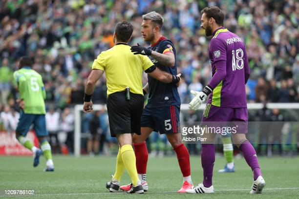Francisco Calvo and Kenneth Kronholm of Chicago Fire have a conversation with an official after a goal by Jordan Morris of Seattle Sounders in the...