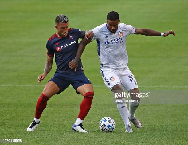 Francisco Calvo of Chicago Fire and Jurgen Locadia of FC Cincinnati battle for the ball at Soldier Field on August 25, 2020 in Chicago, Illinois. The...