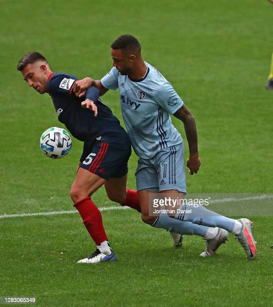 Francisco Calvo of Chicago Fire and Khiry Shelton of Sporting Kansas City battle for the ball at Soldier Field on October 17, 2020 in Chicago,...