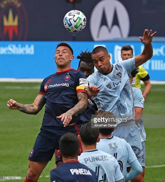 Francisco Calvo of Chicago Fire and Winston Reid of Sporting Kansas City jump for a header on a corner kick at Soldier Field on October 17, 2020 in...